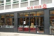 Die Geschäfte von Nur Hier werden künftig nicht mehr aus einer zentralen Produktion beliefert.