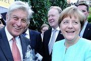 Bundeskanzlerin Angela Merkel und Zentralverbands-Präsident Peter Becker.