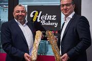 Erweiterung des Brotsortiments: Délifrance und Heinz Bakery mit Achim Zimmermanns und Reinhard Heinz.