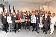 Preisträger und Veranstalter mit Wirtschaftsminister Volker Wissing (Mitte).