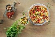 Auf der Pizza sind Bohnen, Chorizo und Kartoffeln nach dem Konzept des Foodpairing miteinander kombiniert.
