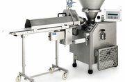 Die Teigteilmaschine Robot, hier mit angebauter Abschneidevorrichtung, arbeitet viskositätsunabhängig.