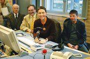 Kollegen des Bäckerfachvereins Hannover mit der Moderatorin Martina Gilica.