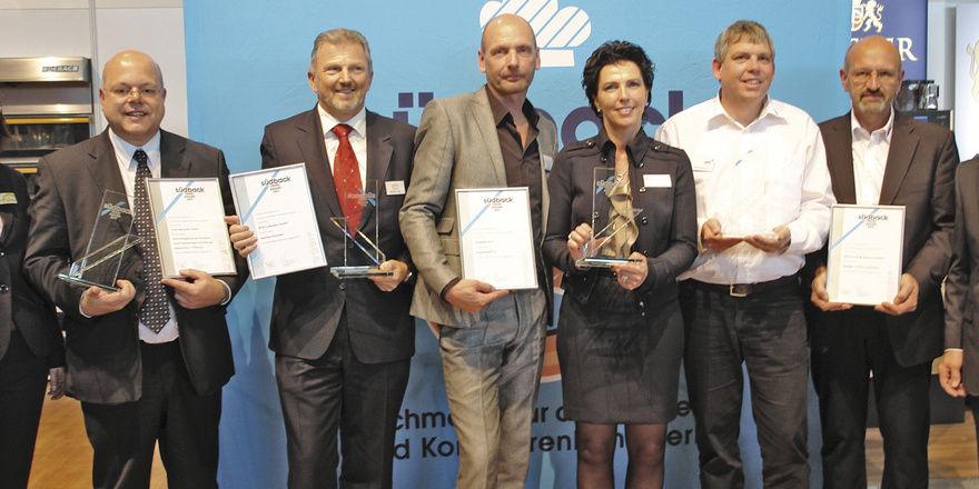"""Preisträger und Veranstalter (v. l.): Ricarda Struppert (Messe Stuttgart), Uwe Hammerath (""""Spritzmatic""""), Rainer Lutz (BFM), Linda Troisfontaine, Joop Kornelis (""""KeyBake""""), Bernard Noll, Günter Abendschön (""""akh""""), LIM Johannes Schultheiß."""