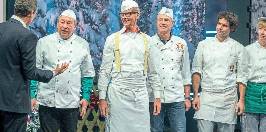Moderator Eckart von Hirschhausen (links) mit den Lebkuchenhausbäckern und Christoph Biemann (2.v.l.).